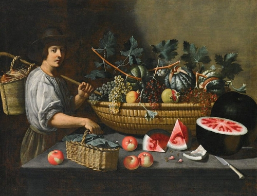 A still life of grapes melons and pomegranates on a stone ledge with a figure carrying a basket.jpg